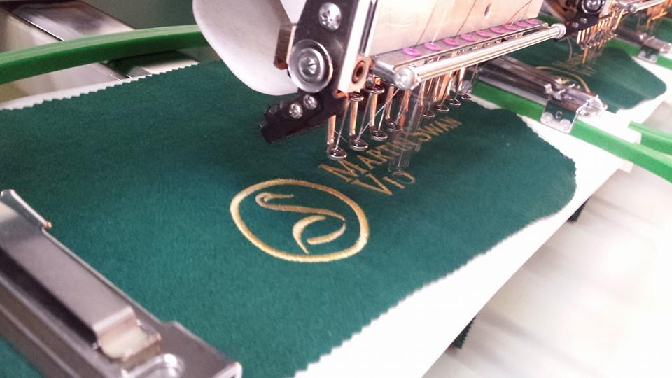 Violin blankets being embroidered